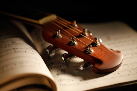 acoustic guitar with musical score