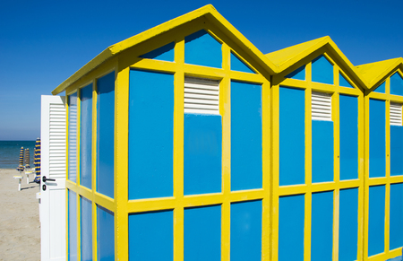 tripped: Beach cabins yellow and blue Stock Photo