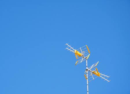 Television antennas with blue sky