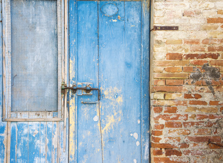 abandoned farmhouse abandoned farmhouse: The blue door of an old abandoned rural farmhouse in the Tuscan countryside (Italy). Stock Photo
