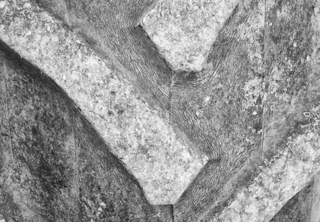 tire tread: Detail up close of a tire tread from a tractor or other heavy duty construction machinery (Black and White).