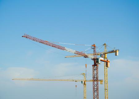 ble: Construction cranes on ble sky.