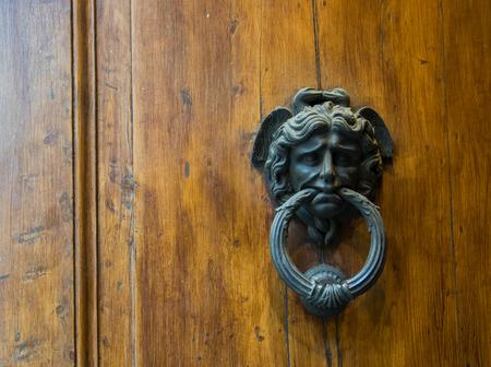 An Antique Door Knocker, Siena, Tuscany, Italy. Stock Photo