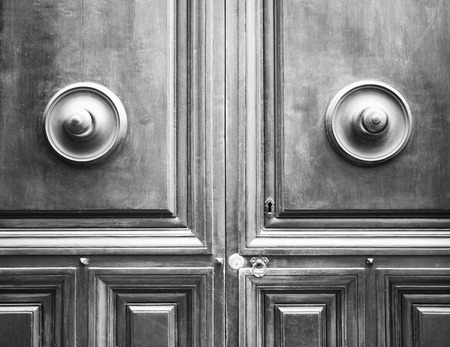 rustiness: Ancient door in the Italian Tuscany. Keyhole useful for concepts (black and white).