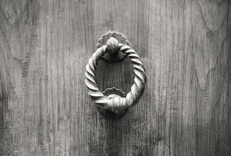rustiness: Door Knocker on a door, Siena, Tuscany, Italy.