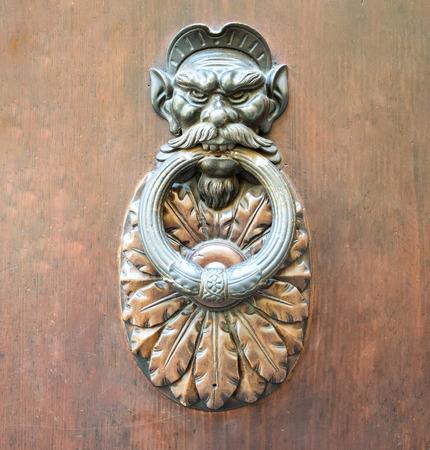 Door Knocker on a door, Siena, Tuscany, Italy.