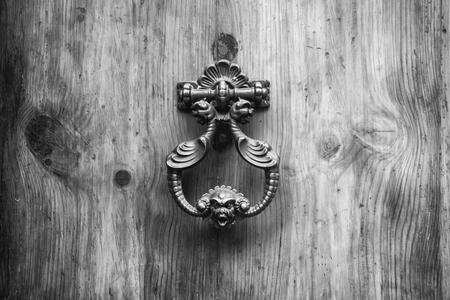 rustiness: Door Knocker on allwood door in Siena, Tuscany.