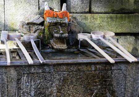 ladles: Chozuya purification fountain ladles. Traditional Japanese Shinto wash basin for ritual cleaningof worshipers at the shrine entrance.