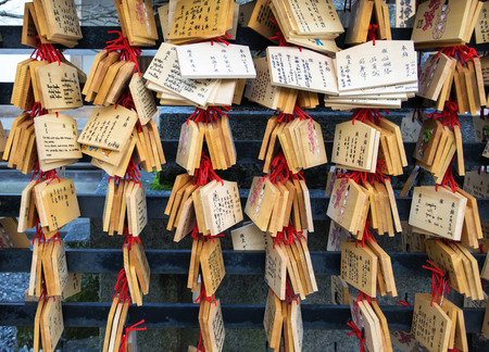 wish desire: Ema plaques. Japanese people write Their wishes such as happiness on wooden tablet and hang it on the inside the temple stands