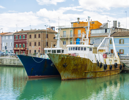 Liguria Italy - Old trawler fishing boats with fishing equipment docked in port - Lerici, La Spezia, Liguria, Italy