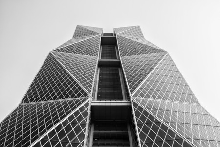 tallest bridge: Kaohsiung, Taiwan - April 2016- Office Building against the blue sky (black and white).