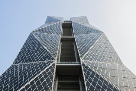 tallest bridge: Kaohsiung, Taiwan - April 2016- Office Building against the blue sky.