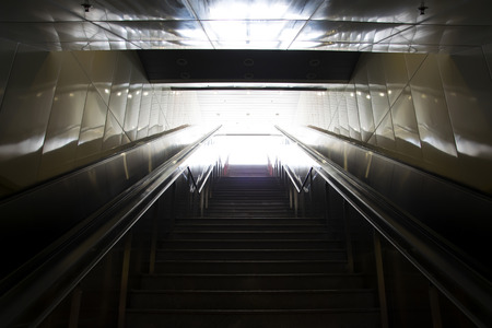 Stairs leading out of concrete pedestrian subway to the city. Concept of success. Stock Photo