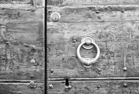 rustiness: Details of an ancient Italian door in Florence, Italy (Black and White).
