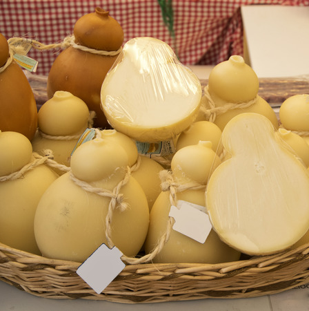 Aged forms of caciocavallo cheese for sale in the italian market. Stock Photo