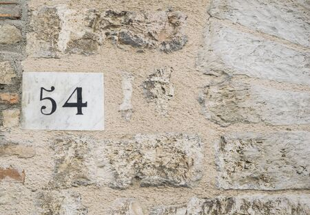 numero: House number 54 sign.