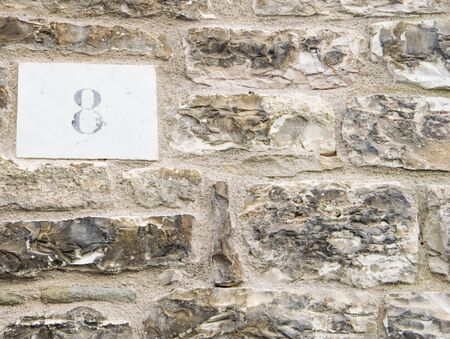numero: House number 8 sign.