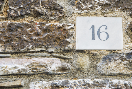 numero: House number 16 sign.