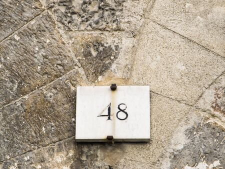 numero: House number 48 sign.