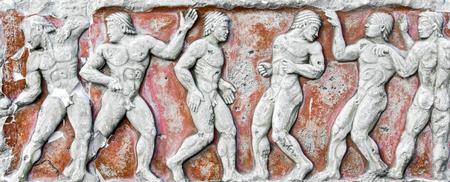 escultura romana: Romanos bajo relieve y escultura detalles en piedra.