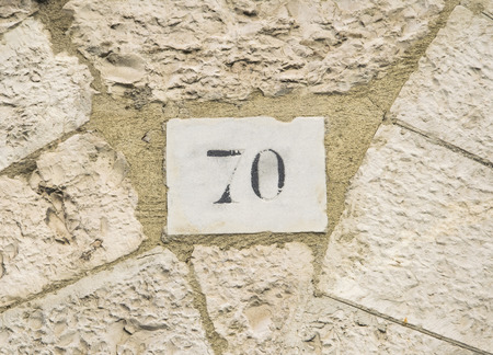numero: House number 70 sign. Stock Photo