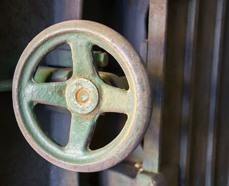dialectic: Round handle lathe Industrial lathe tool and part of the lathe. Stock Photo