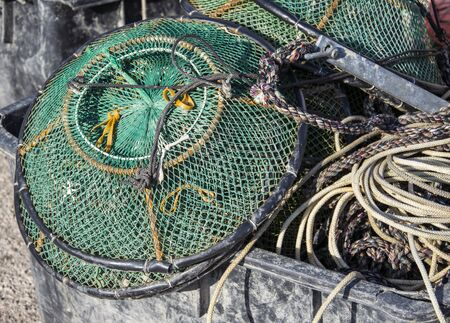 ploy: Plastic crates filled with fishing nets