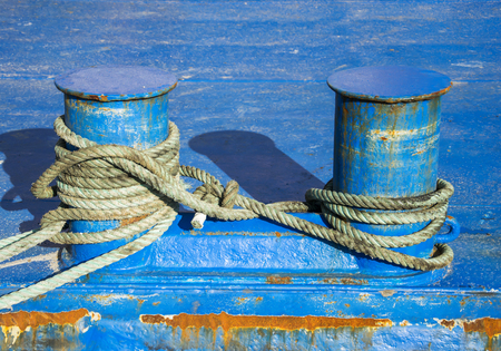 Bollard and mooring rope for mooring of yachts and boats. Stock Photo