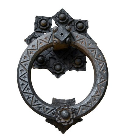 Ancient door knocker isolated on white background.