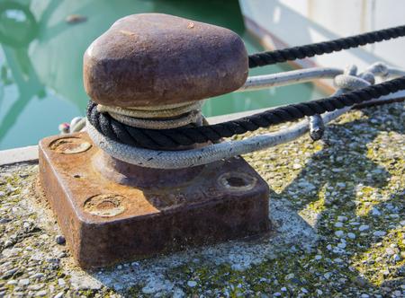 Bollard and mooring rope for mooring of yachts and boats Stock Photo