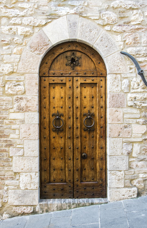 The entrance wooden door in an old Italian house (black and white).