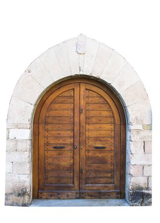 The entrance wooden door in an old Italian house. Isolated on white background. Clipping path included.