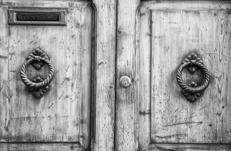 door knob: Details of an ancient Italian door in Florence, Italy (Black and White).