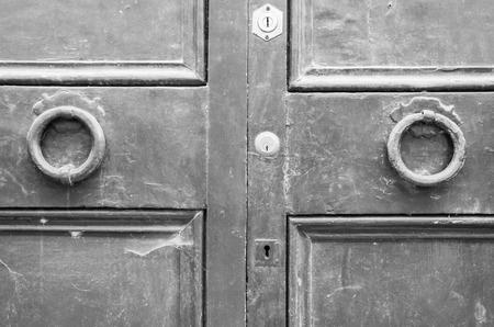 door knob: Details of an ancient Italian door, black and white.
