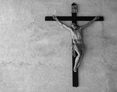tortured: Jesus Christ was crucified. Catholic religion symbol. Black and white.