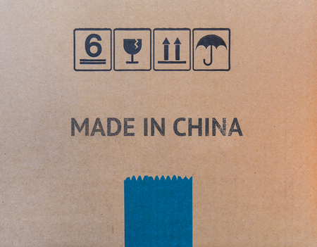 MADE IN CHINA written on brown cardboard box. Banco de Imagens
