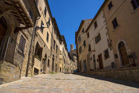 Beautiful narrow street of historic tuscan city Volterra, Italy