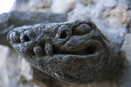Snake stone sculpture depicting a guardian in the old town of Civita di Bagnoregio, Lazio, Italy Stock Photo