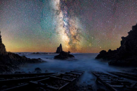 The Milky Way above the beach covered by a blanket of stars