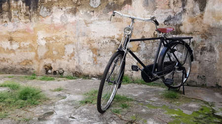 Old rustic bicycle on old brick background. Bicycle, Cycling, Retro Style