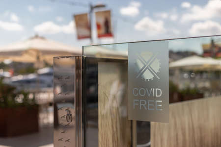 Covid free sign at the entrance of a restaurant at Barcelona's harbour after the end of the lockdown due to the Covid-19 emergency Foto de archivo