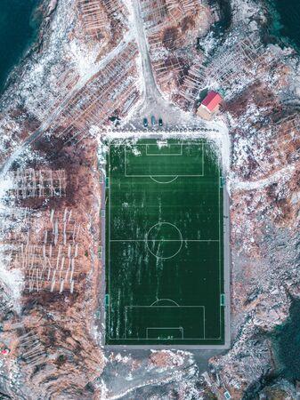 Incredible soccerfield, by the sea and mountains, Lofoten Islands Standard-Bild