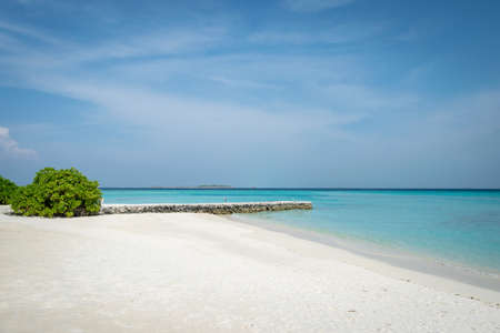 white sand beach and turquoise water on an island of Maldives