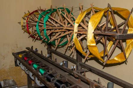 craft wood machine to make embroidery patterns in vietnamese workshop. Vietnam. Hand embroidery Stockfoto