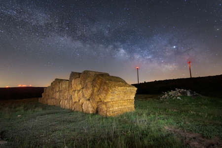 straw on the cleaned field and starry sky. Countryside Rural Landscape Stock fotó