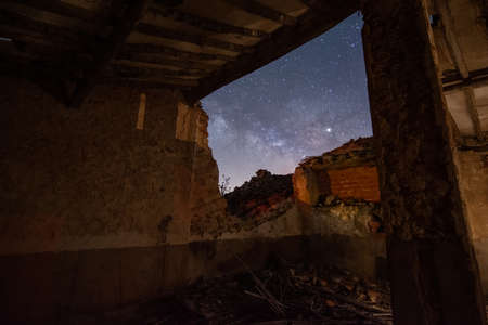 Starry night view from an abandoned house. Natural Night Starry Sky