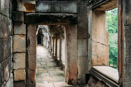 Corridor made of rustic rocks in one of the temples in Angkor, Siem Reap, Cambodia - UNESCO World Heritage Site 1992 写真素材