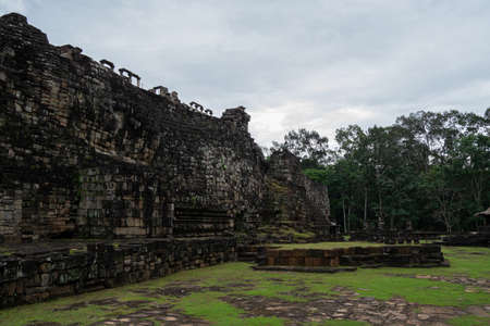 Many neglected rocks from the temple in Angkor, Siem Reap, Cambodia under a cloudy sky - World Heritage by UNESCO in 1992 - Colourful photo