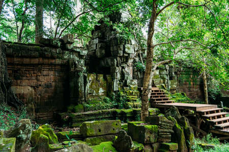 Mould-filled rocks from ruined Angkor temple, Siem Reap, Cambodia under a cloudy sky - World Heritage by UNESCO in 1992 - Colourful photo 写真素材
