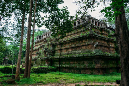 An amazing temple in Angkor, Siem Reap, Cambodia covered by vegetation - UNESCO World Heritage Site 1992 - Bottom view